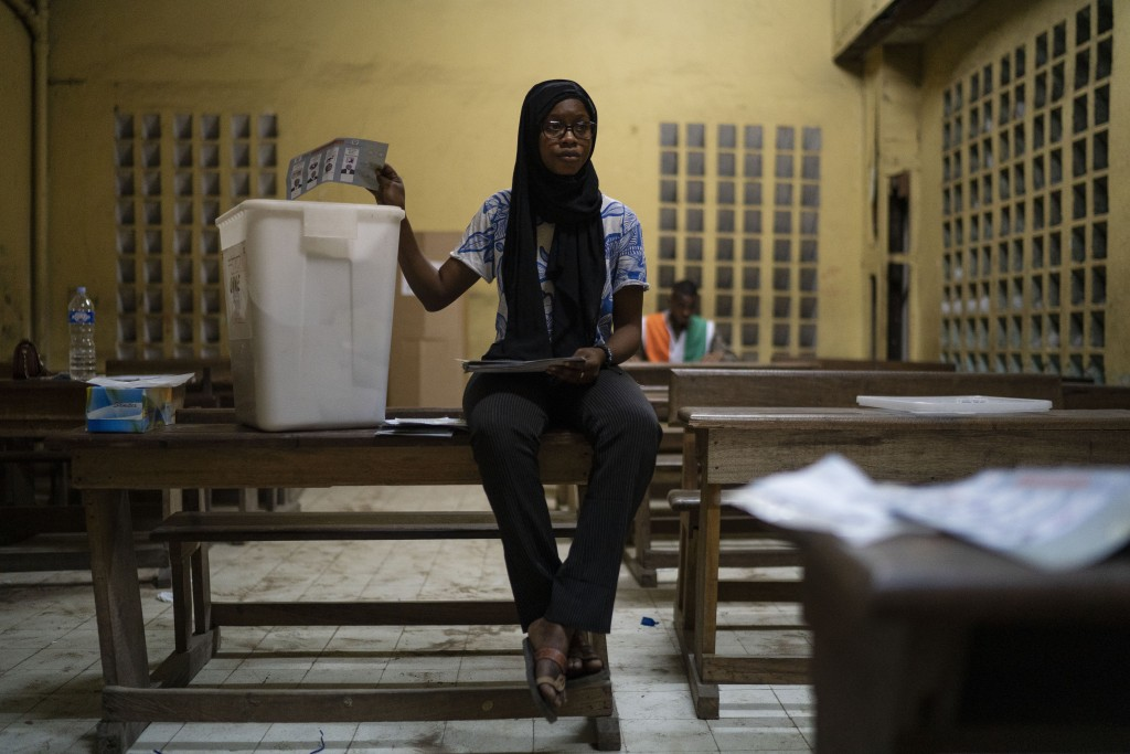 A poll worker counts votes at a polling station during presidential elections in Abidjan, Ivory Coast, Saturday, Oct. 31, 2020. Some tens of thousands...