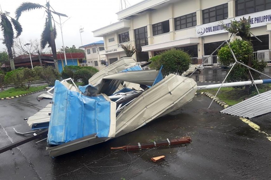 In this photo provided by the Civil Aviation Authority of the Philippines, debris from a damaged structure at the Naga airport in Naga city, central P...