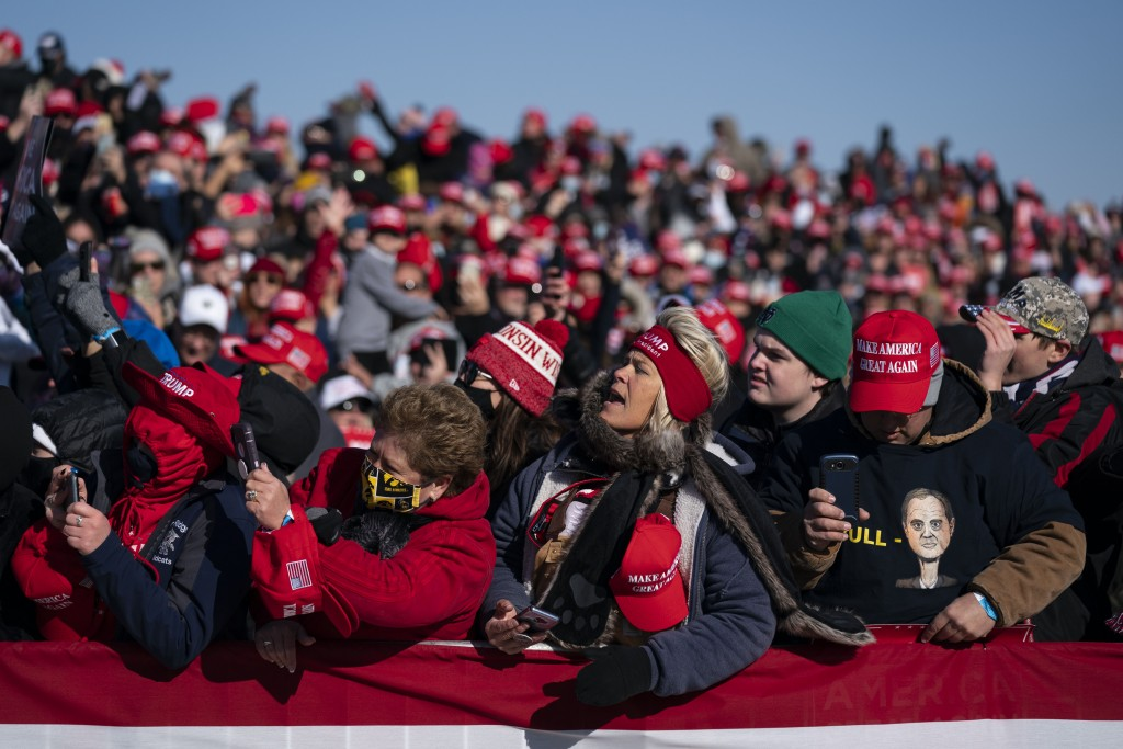 Supporters of President Donald Trump listen to him speak during a campaign rally at Dubuque Regional Airport, Sunday, Nov. 1, 2020, in Dubuque, Iowa. ...