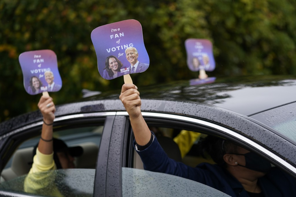 "Biden supporters hold up fans during a ""Souls to the Polls"" drive-in rally for Democratic presidential candidate former Vice President Joe Biden at Sh..."