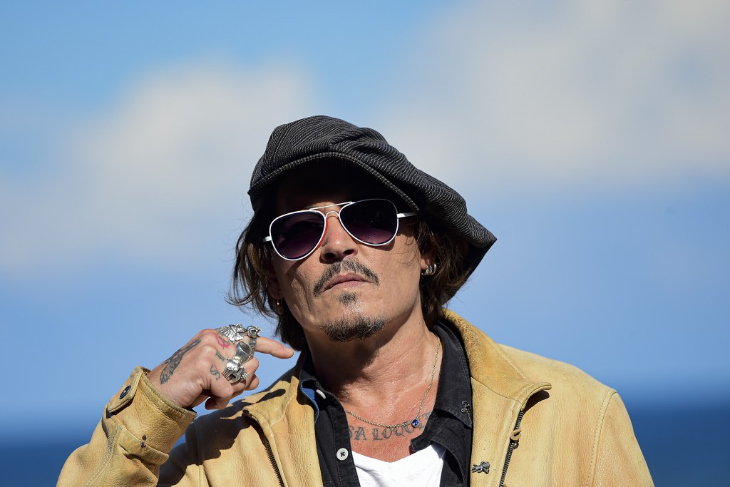 "FILE - In this file photo dated Sunday, Sept. 20, 2020, US actor and film producer Johnny Deep during the photocall for his film ""Crock of Gold: A Few..."