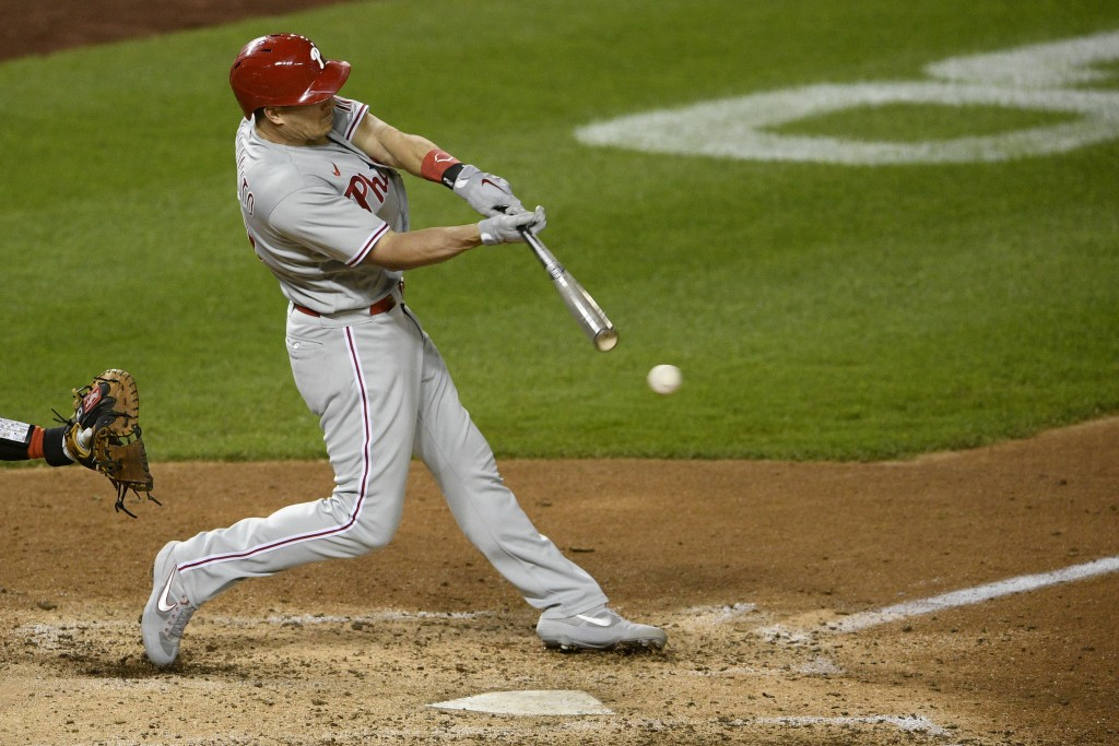 File-This Sept. 22, 2020, file photo shows Philadelphia Phillies' J.T. Realmuto batting during the second baseball game of a doubleheader against the ...