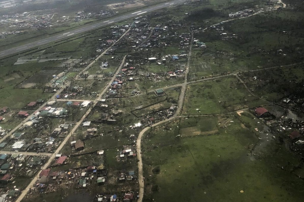 In this aerial photo provided by the Philippine Coast Guard, damaged houses are seen at Catanduanes province, eastern Philippines by the Philippine Co...