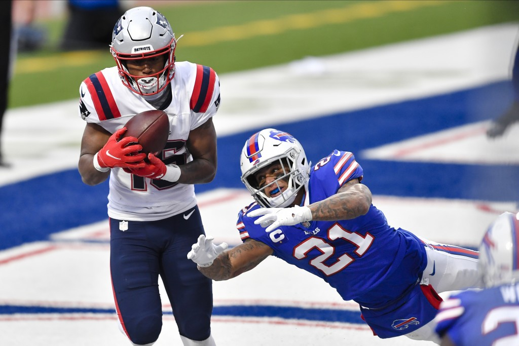 Buffalo Bills free safety Jordan Poyer (21) dives for the ball thrown to New England Patriots' Jakobi Meyers (16) for a two point conversion during th...