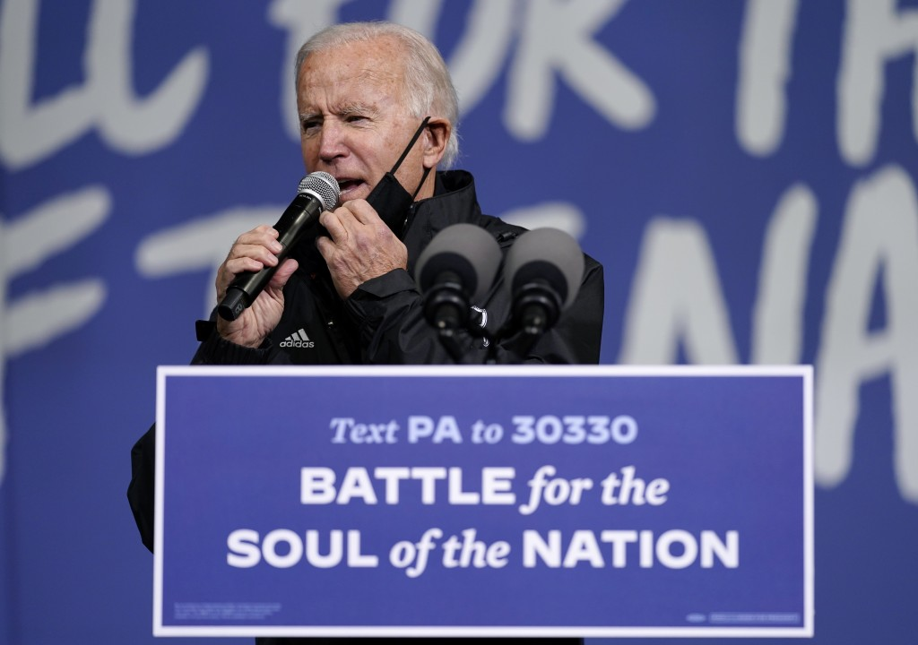 "Democratic presidential candidate former Vice President Joe Biden arrives to speak at a ""Souls to the Polls"" drive-in rally at Sharon Baptist Church, ..."