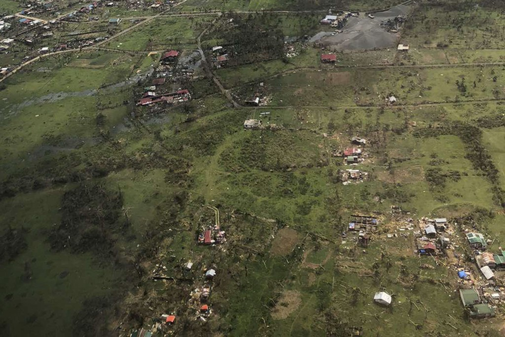 In this aerial photo provided by the Philippine Coast Guard, damaged homes are seen at Catanduanes province, eastern Philippines on Monday Nov. 2, 202...