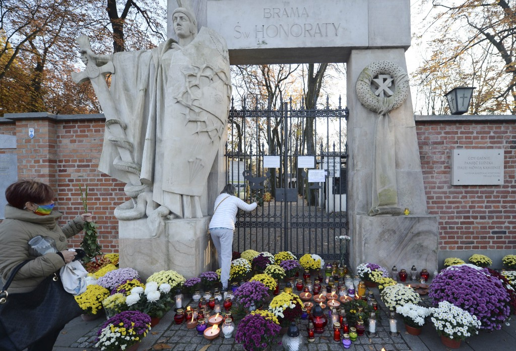 Flowers and candles people have placed outside of Powazki cemetery after Poland's government closed all cemeteries in an attempt to curb the spread of...