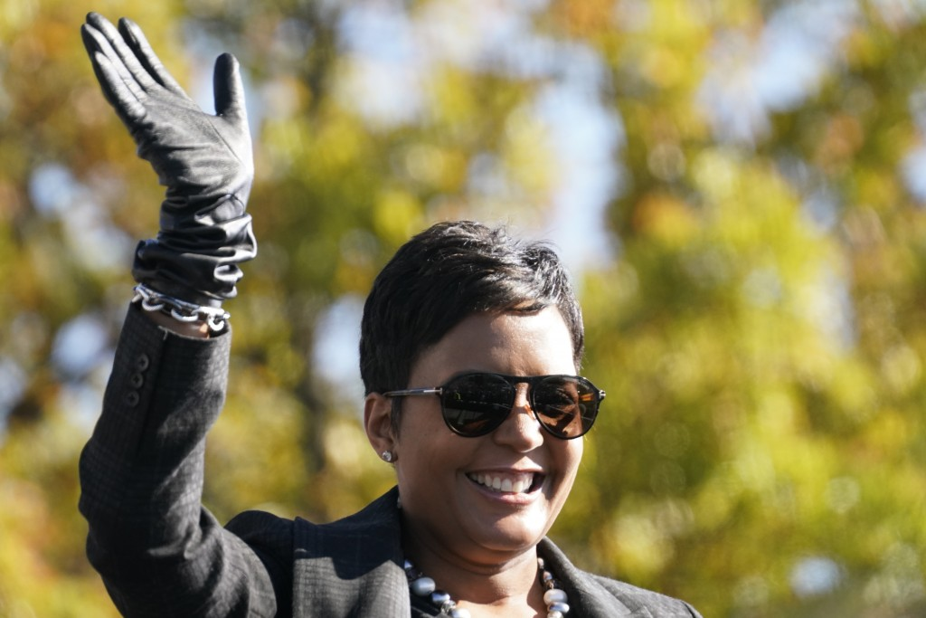Atlanta Mayor Keisha Lance Bottoms speaks to Biden supporters as they wait for former President Barack Obama to arrive and speak at a rally as he camp...