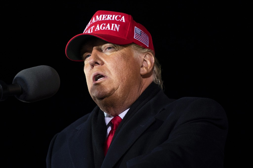 President Donald Trump speaks at a campaign rally at Gerald R. Ford International Airport, early Tuesday, Nov. 3, 2020, in Grand Rapids, Mich. (AP Pho...