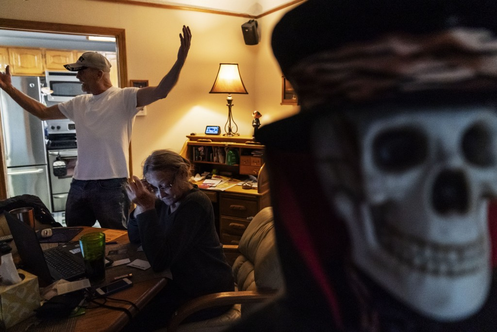 Trump supporters Terry, left, and Sherry Frandle talk about at their concerns of what a Biden presidency could bring, in their home in Saint Clair Sho...