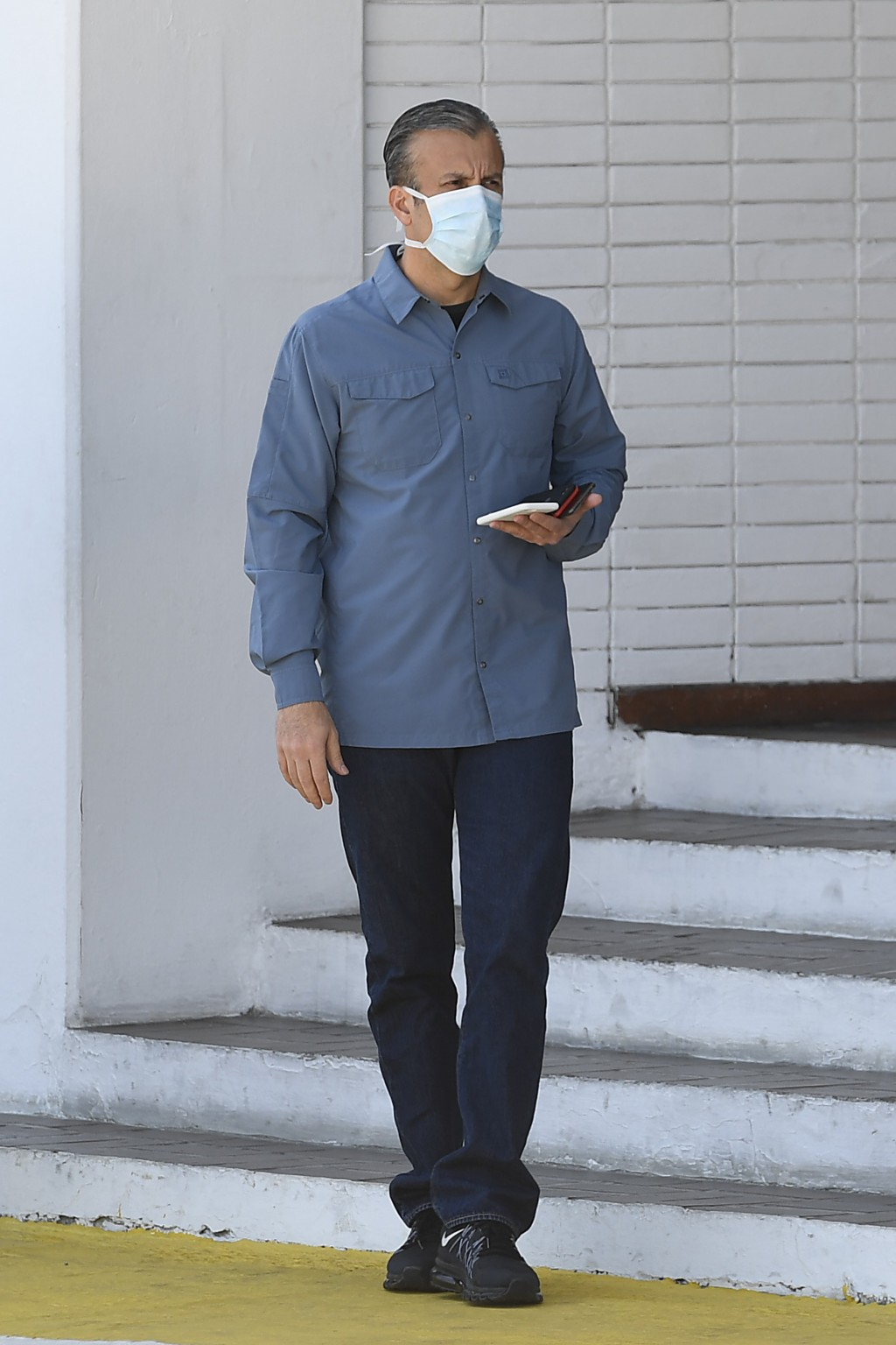 FILE - In this March 28, 2020, Venezuela's Oil Minister Tareck El Aissami, wearing a protective face mask as a precaution against the spread of the ne...