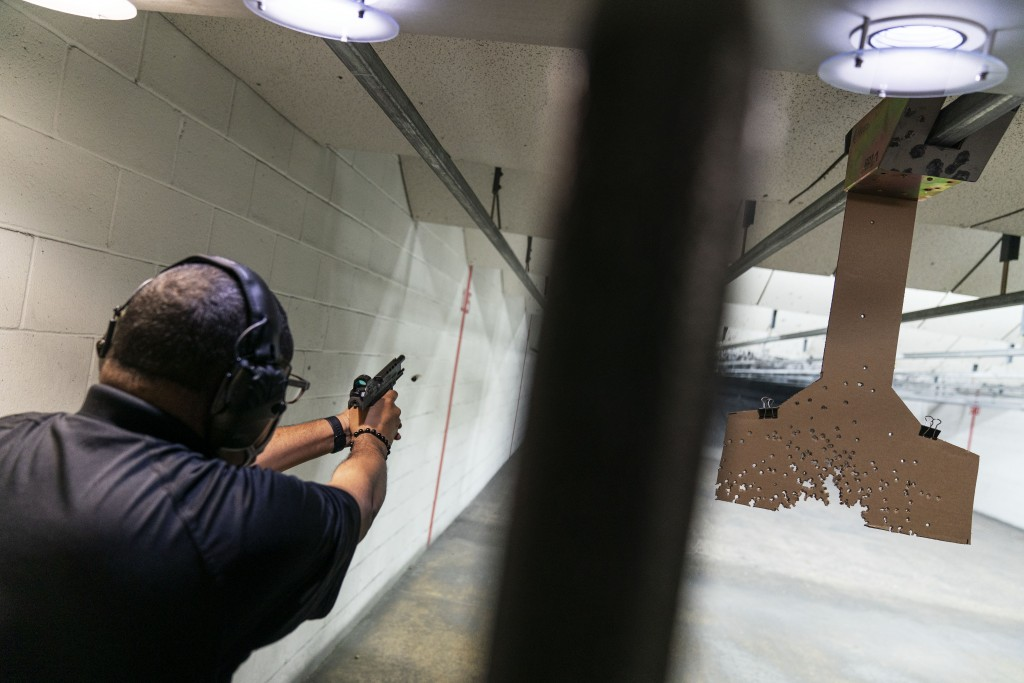 Chad King, who started the Detroit chapter of the National African American Gun Association and teaches de-escalation training, practices at a shootin...