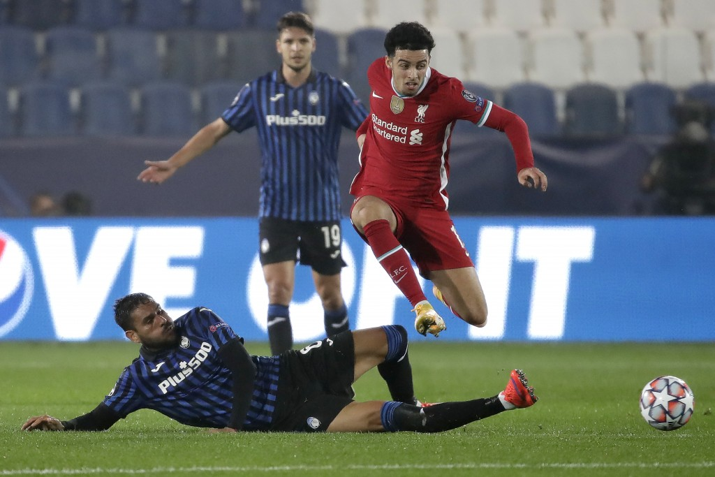 Atalanta's Jose Luis Palomino, on the ground, fights for the ball with Liverpool's Trent Alexander-Arnold during the Champions League, group D soccer ...