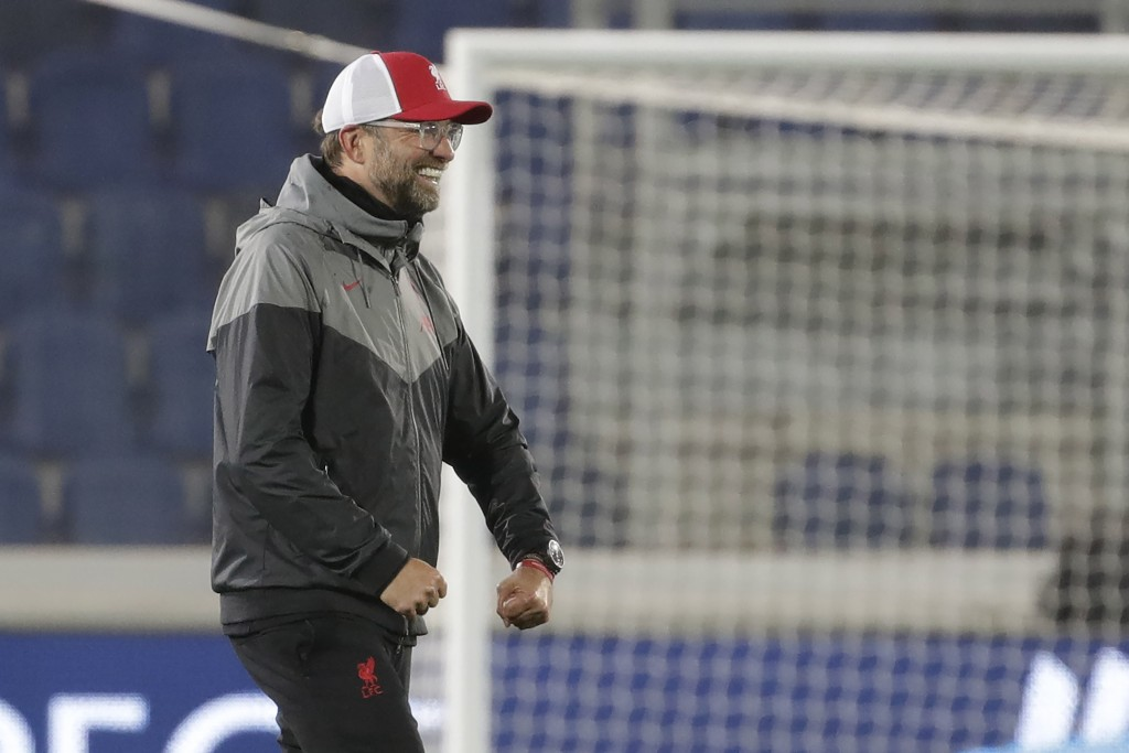 Liverpool's manager Jurgen Klopp celebrates after the end of the Champions League, group D soccer match between Atalanta and Liverpool, at the Gewiss ...