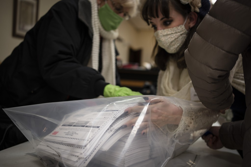 Election staff members pack ballots after polls closed at the Moose Lodge on Election Day, Tuesday, Nov. 3, 2020, in Kenosha, Wis. (AP Photo/Wong Maye...