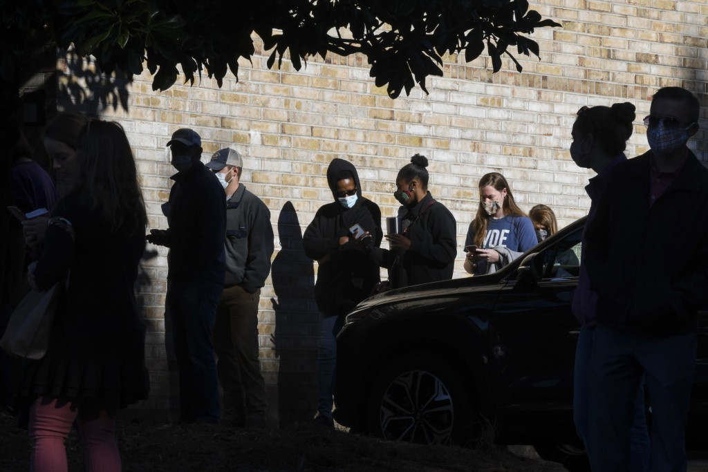 Voters wait in line to cast their ballots in the 2020 election Tuesday, Nov. 3, 2020, in Auburn, Ala. (AP Photo/Julie Bennett)