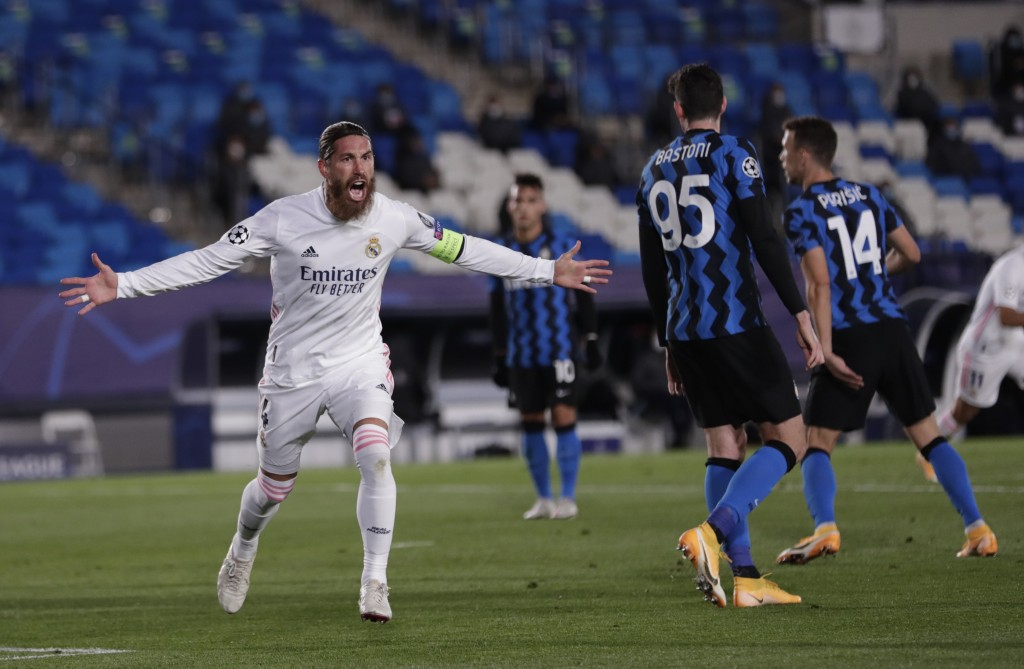 Real Madrid's Sergio Ramos celebrates after scoring his side's second goal during the Champions League group B soccer match between Real Madrid and In...