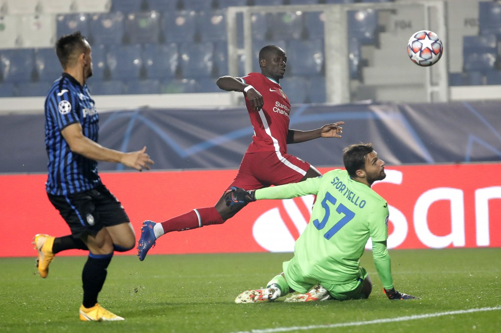 Liverpool's Sadio Mane, center, scores against Atalanta during the Champions League, group D soccer match between Atalanta and Liverpool, at the Gewis...