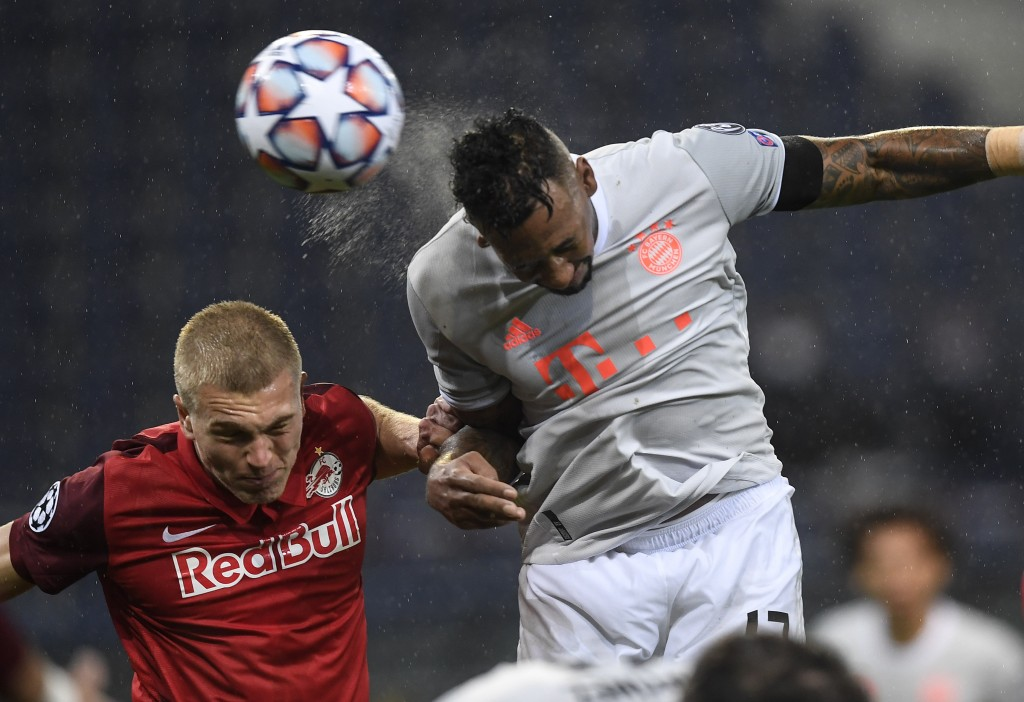Bayern's Jerome Boateng heads his side's third goal during the Champions League group A soccer match between RB Salzburg and Bayern Munich in Salzburg...