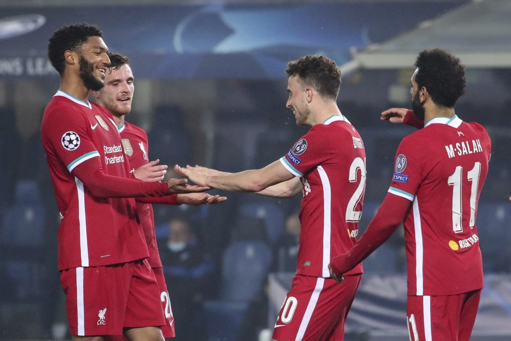 Liverpool's Diogo Jota, center, celebrates after scoring his second goal against Atalanta during the Champions League, group D soccer match between At...