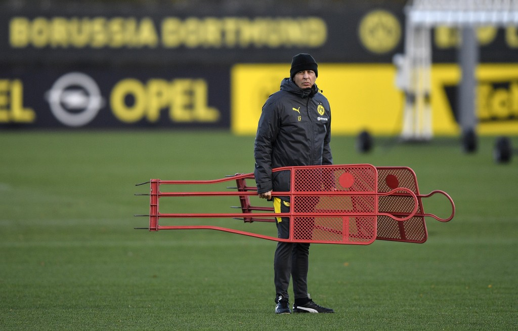 Dortmund's head coach Lucien Favre prepares during a training session prior the Champions League group F soccer match between Club Brugge and Borussia...