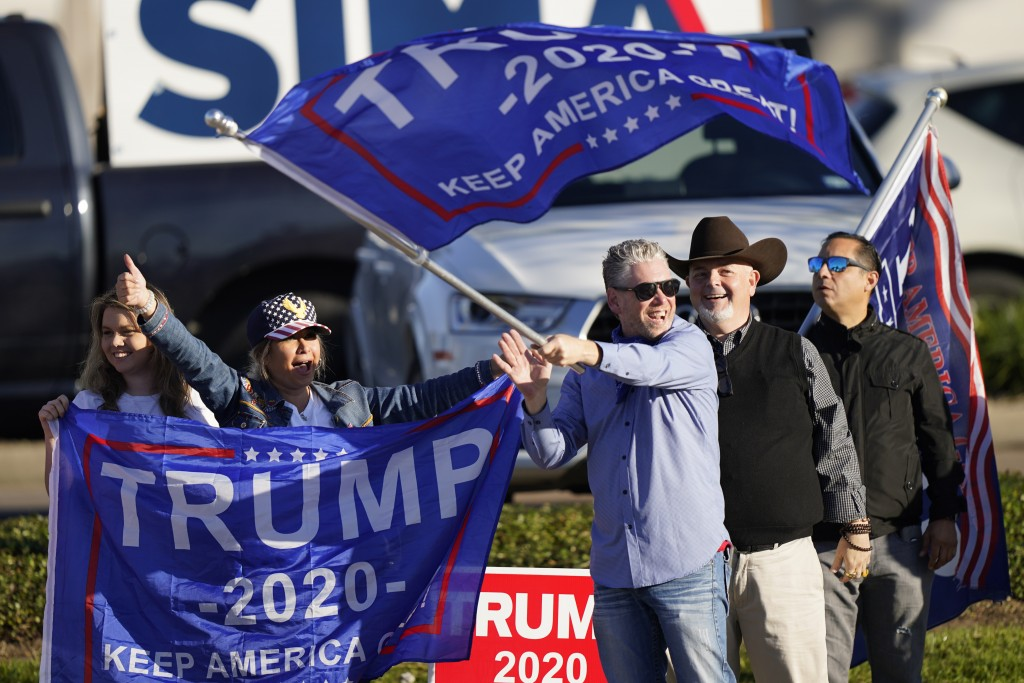 Supporters of President Trump cheer as passing cars honk their horns near a polling location on Election Day, Tuesday, Nov. 3, 2020, in Houston. (AP P...