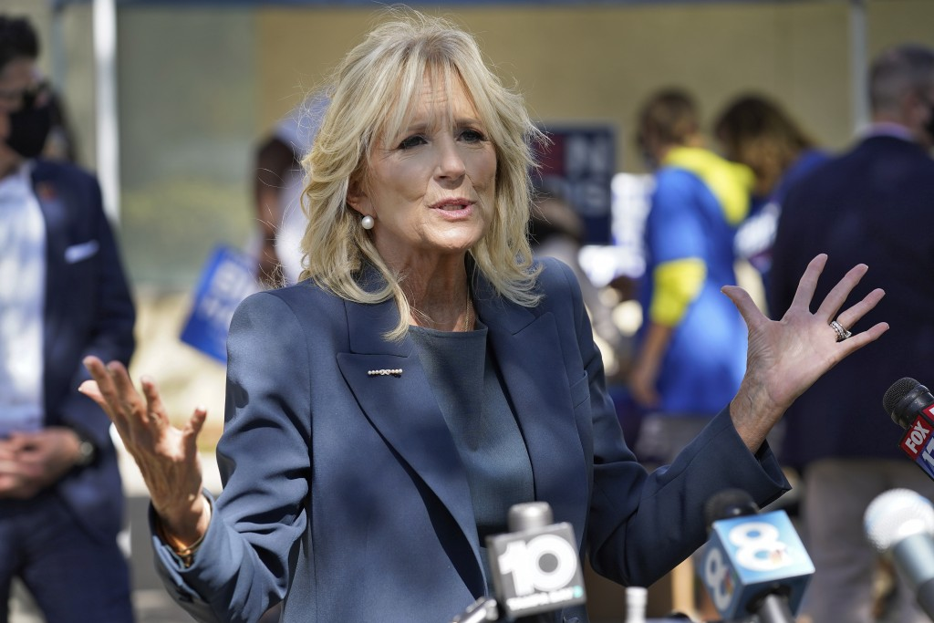 Jill Biden gestures as she speaks to reporters while campaigning for her husband Democratic presidential candidate and former Vice President Joe Biden...
