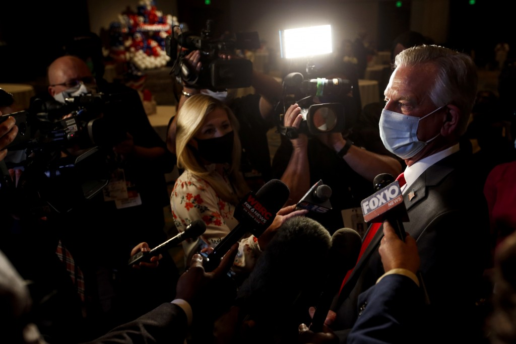 Republican U.S. Senate candidate Tommy Tuberville talks with media as he arrives for the watch party at the Renaissance Hotel on Tuesday, Nov. 3, 2020...