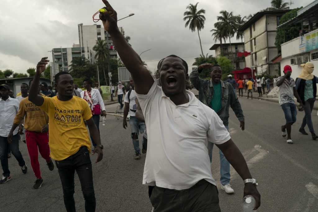 """A supporter of the opposition parties shouts """"Ivory Coast"""" during a protest after security forces blocked the access to the house of the former presid..."""