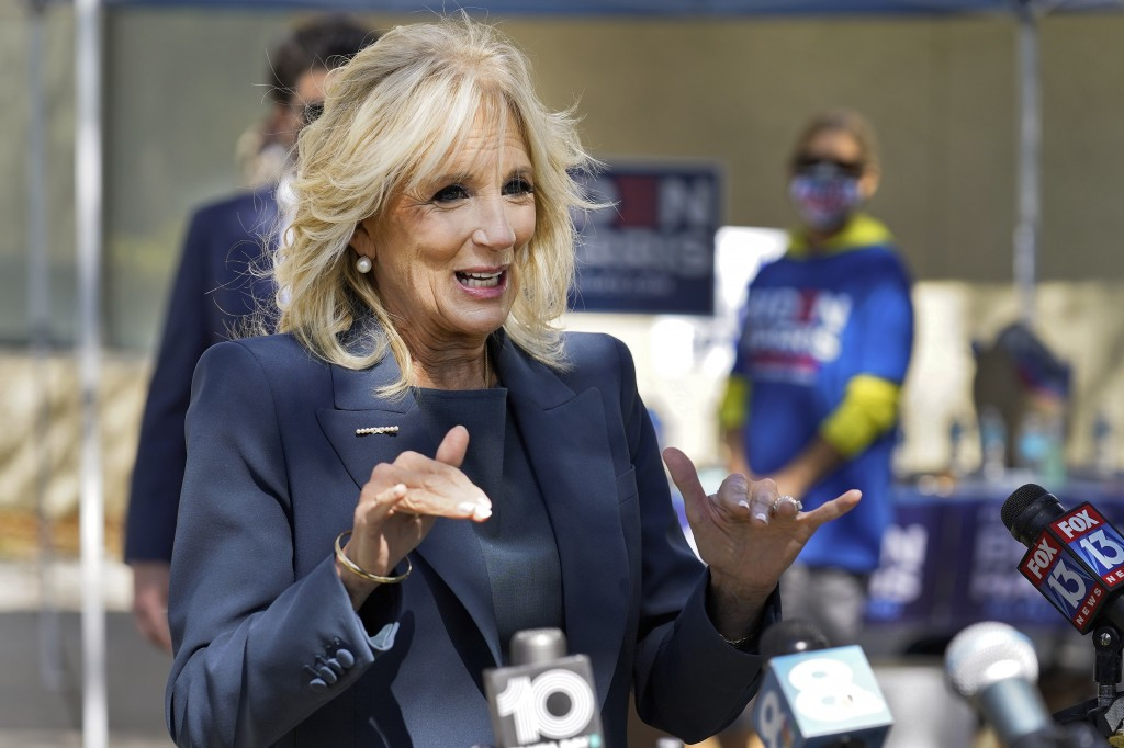 Jill Biden speaks to reporters while campaigning for her husband Democratic presidential candidate and former Vice President Joe Biden, during a votin...