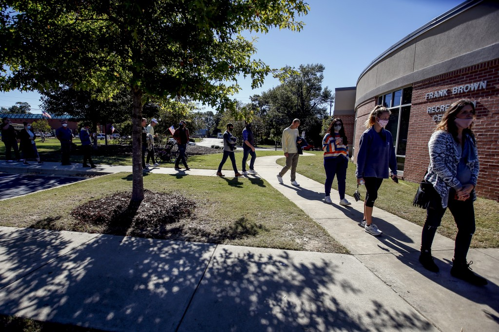 Voters stand in long lines waiting to cast their vote on Tuesday, Nov. 3, 2020, in Auburn, Ala. (AP Photo/Butch Dill)