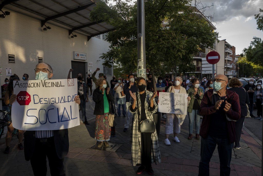 Residents of restricted mobility areas in Madrid due to the coronavirus outbreak gather during a protest to demand more resources for public health sy...