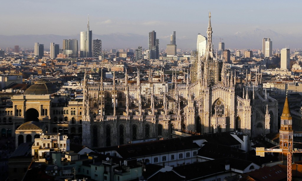 FILE - In this Jan. 4, 2017 file photo, the pinnacles of the Duomo gothic cathedral are illuminated by the afternoon sun and backdropped by the new bu...