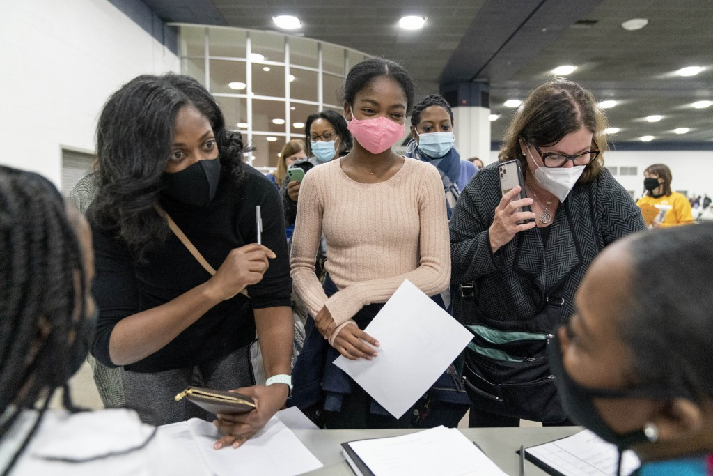 Denice Asbell, left, brings her daughter Rhegan, 13, center, down to the central counting board to observe democratic election challengers watching ba...
