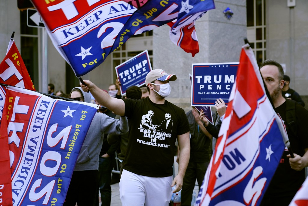 Supporter of President Donald Trump demonstrate outside the Pennsylvania Convention Center where votes are being counted, Thursday, Nov. 5, 2020, in P...