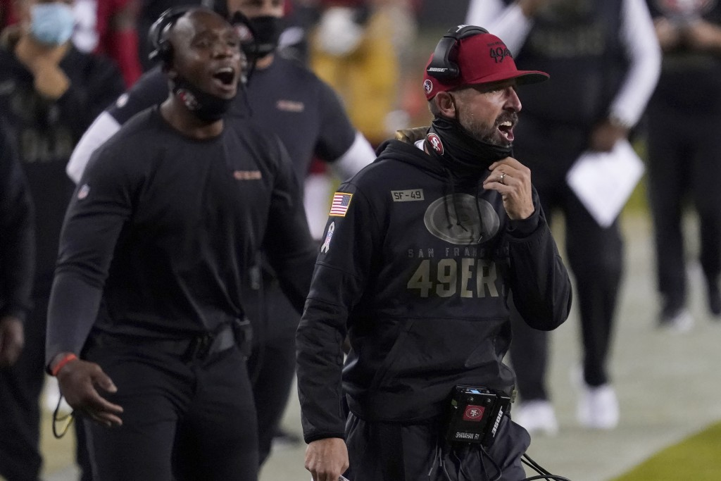 San Francisco 49ers head coach Kyle Shanahan, right, yells during the first half of an NFL football game between the 49ers and the Green Bay Packers i...