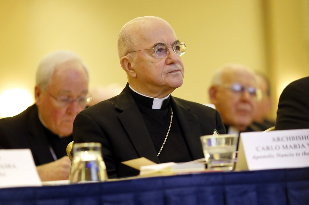 FILE - In this Nov. 16, 2015 file photo, Archbishop Carlo Maria Vigano, Apostolic Nuncio to the U.S., listens to remarks at the U.S. Conference of Cat...