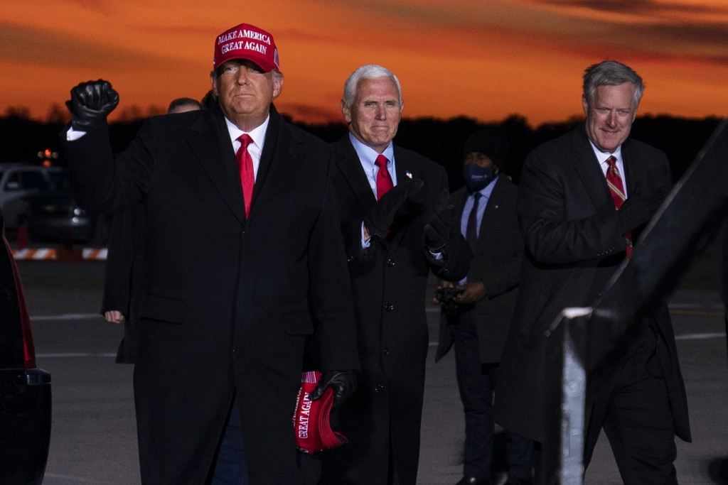 President Donald Trump and Vice President Mike Pence arrive for a campaign rally at Cherry Capital Airport, Monday, Nov. 2, 2020, in Traverse City, Mi...