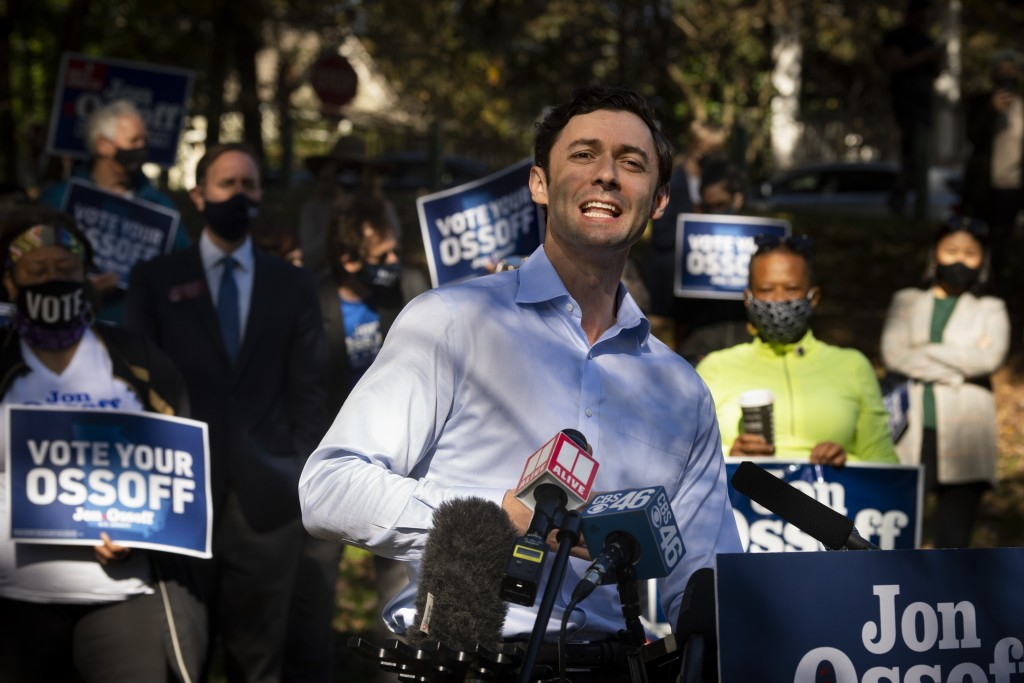 Georgia Democratic candidate for U.S. Senate Jon Ossoff speaks to the media as he rallies supporters for a run-off against Republican candidate Sen. D...