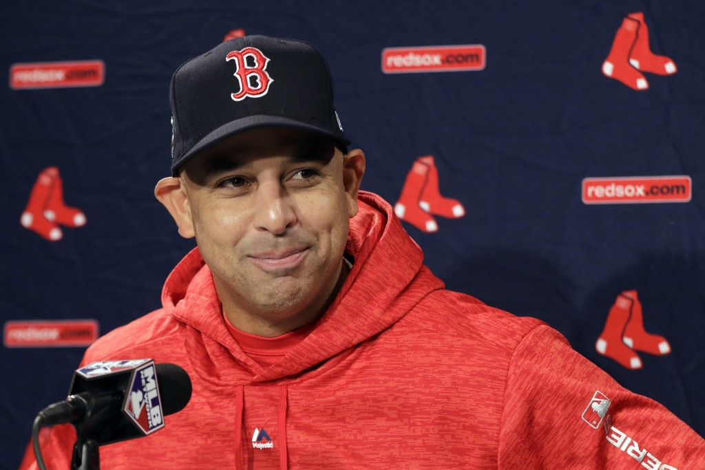 FILE- In this Oct. 21, 2018, file photo, Boston Red Sox manager Alex Cora speaks to media during a baseball work out at Fenway Park in Boston, as they...