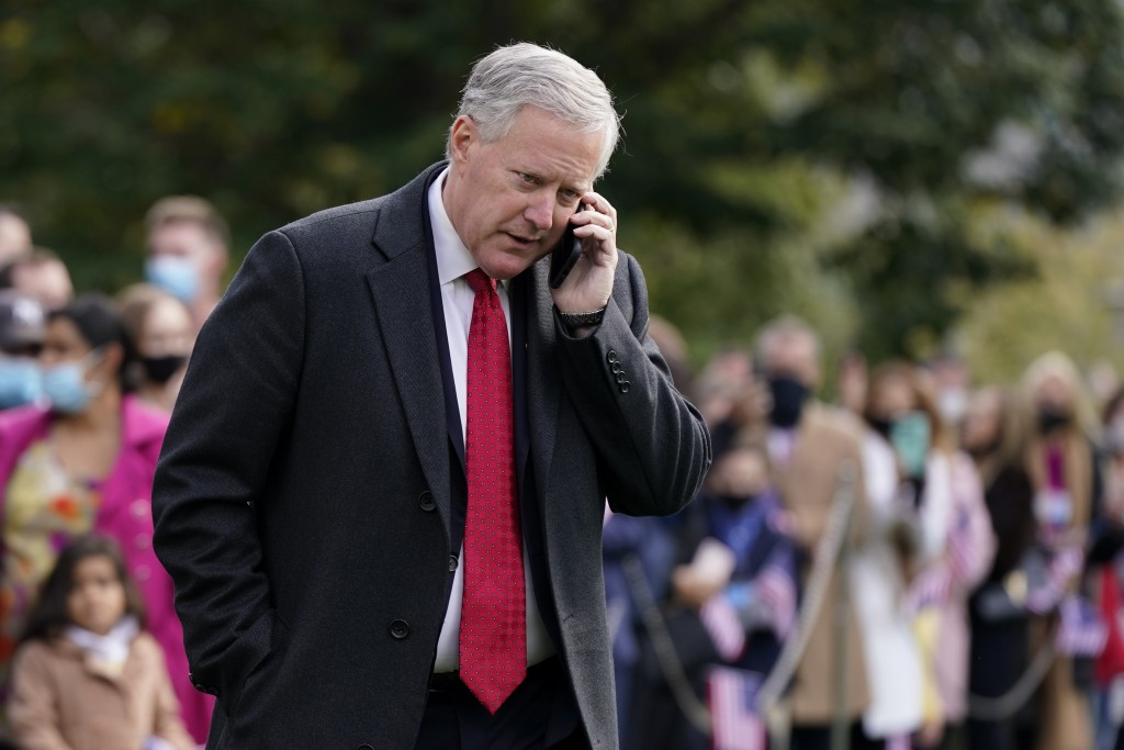 In this Oct. 30, 2020, photo, White House chief of staff Mark Meadows speaks on a phone on the South Lawn of the White House in Washington. Meadows ha...