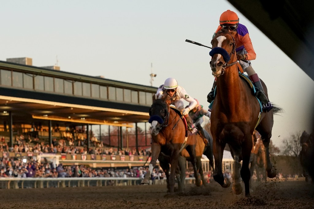 John Velazquez, right, rides Authentic to win the Breeder's Cup Classic horse race at Keeneland Race Course, in Lexington, Ky., Saturday, Nov. 7, 2020...