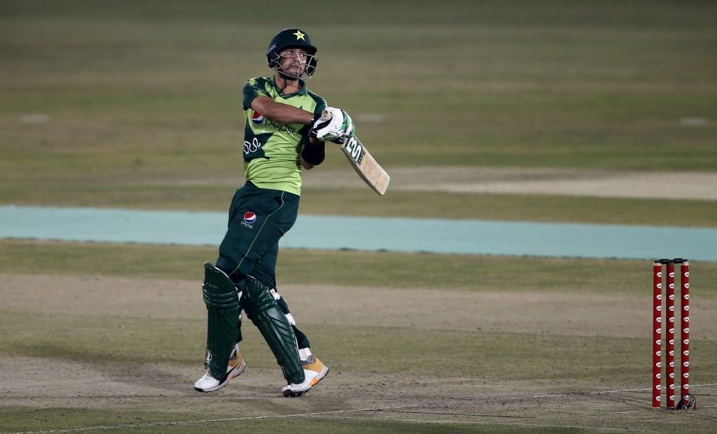 Pakistani batsman Haider Ali follows the ball after playing a shot for boundary during the 2nd Twenty20 cricket match against Zimbabwe at the Pindi Cr...