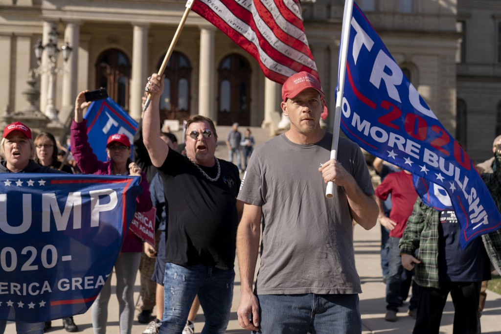 Trump supporters demonstrating the election results face off with counter protesters at the State Capitol in Lansing, Mich., Saturday, Nov. 7, 2020. D...