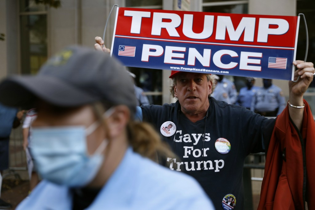 A supporter of President Donald Trump demonstrates outside the Pennsylvania Convention Center, Saturday, Nov. 7, 2020, in Philadelphia, after Democrat...
