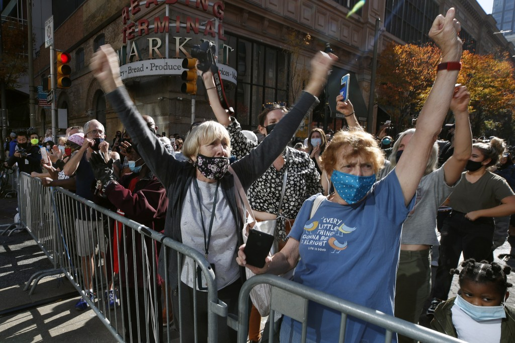People celebrate outside the Pennsylvania Convention Center, Saturday, Nov. 7, 2020, in Philadelphia, after Democrat Joe Biden defeated President Dona...