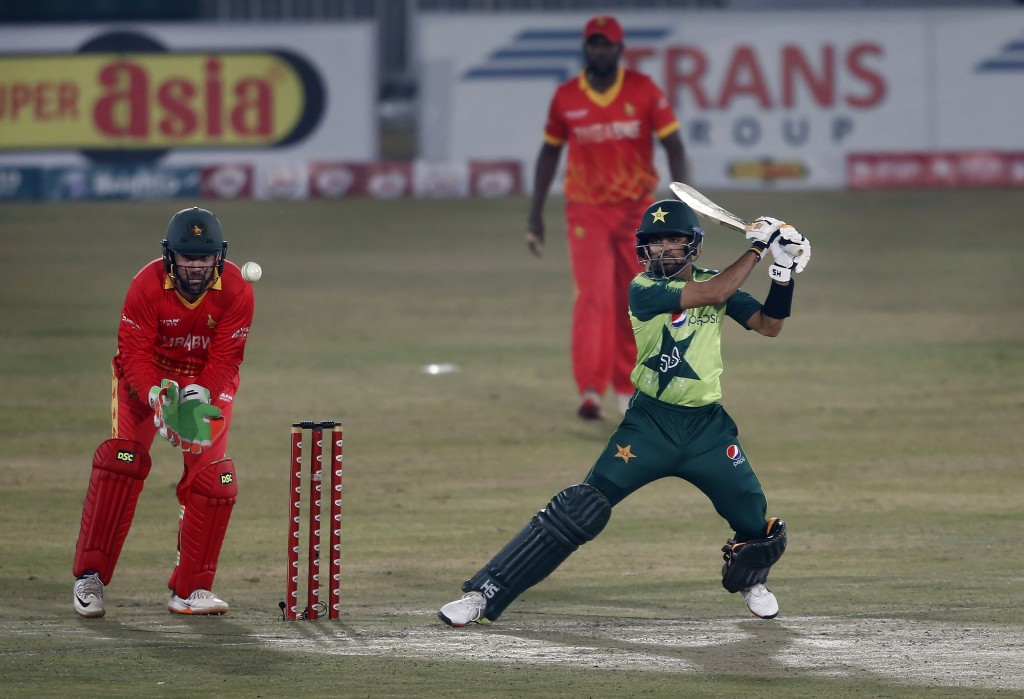 Pakistani batsman Babar Azam, right, plays a shot while Zimbabwe's wicketkeeper Brendan Taylor, left, watches during their 2nd Twenty20 cricket match ...