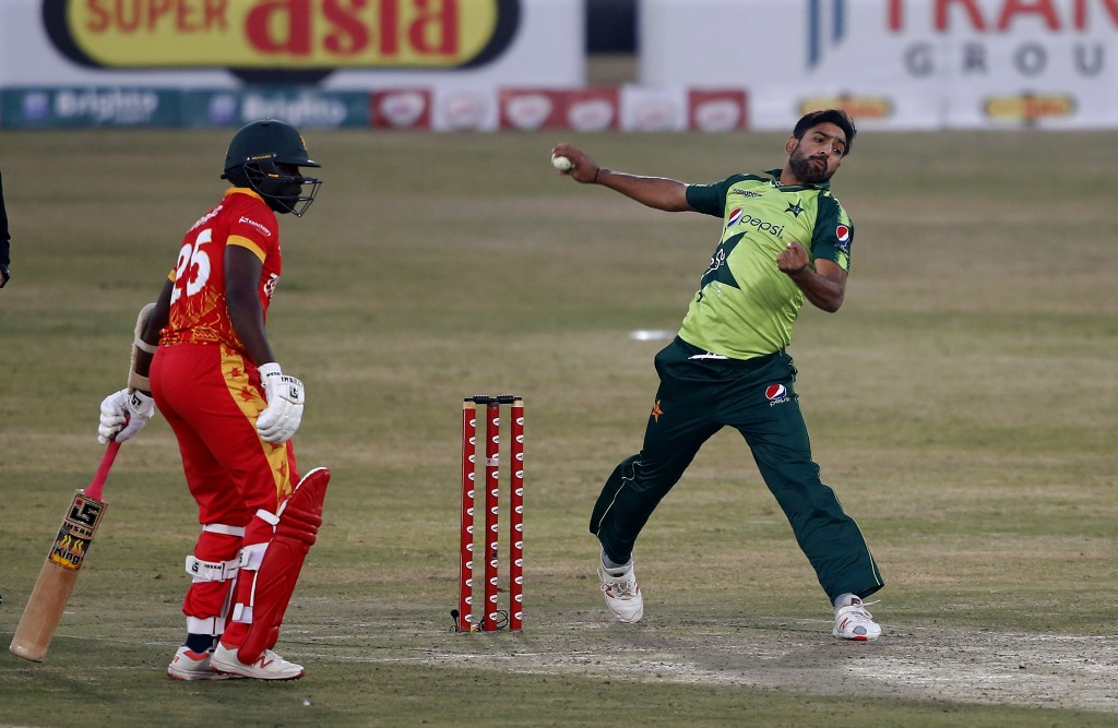 Pakistani pacer Haris Rauf, right, delivers a ball while Zimbabwe's batsman Donald Tiripano watches during their 2nd Twenty20 cricket match at the Pin...