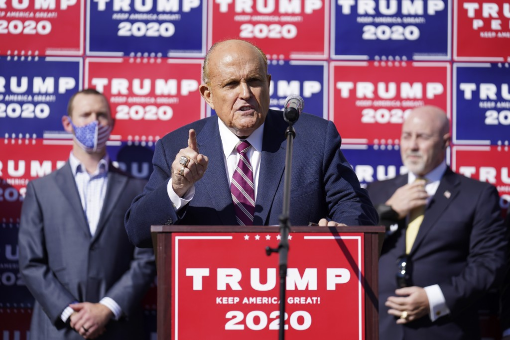 Former New York mayor Rudy Giuliani, a lawyer for President Donald Trump, speaks during a news conference on legal challenges to vote counting in Penn...