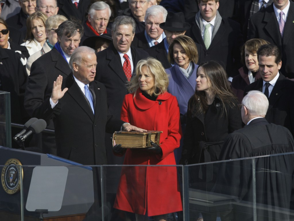 Vice President-elect Joe Biden, with his wife Jill at his side, takes the oath of office from Justice John Paul Stevens, as his wife holds the Bible a...